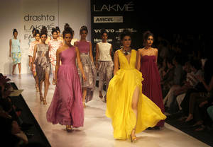 Photo -   Indian models display creations by Drashta during the Lakme Fashion Week in Mumbai, India, Saturday, Aug. 4, 2012. (AP Photo/Rafiq Maqbool)
