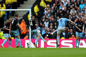Photo - Manchester City's Samir Nasri, second right, scores his side's first goal during the English Premier League soccer match between Manchester City and West Ham at the Etihad Stadium in Manchester, England, Sunday May 11, 2014.  (AP Photo/Jon Super)