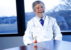 Photo - Dr. John S. Muchmore poses for a photo with a model of the thyroid as he talks about thyroid removal surgery at Integris in Oklahoma City, Thursday, March 21, 2013. Photo by Bryan Terry, The Oklahoman