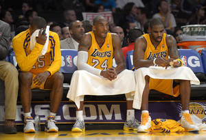 Photo - Los Angeles Lakers forward Metta World Peace, from left, guard Kobe Bryant and forward Antawn Jamison sit on the bench during the second half of their NBA basketball game against the Oklahoma City Thunder, Friday, Jan. 11, 2013, in Los Angeles. The Thunder won 116-101. (AP Photo/Mark J. Terrill)