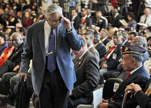 Photo -   Rep. Charles Rangel, D-N.Y., salutes surviving members of the Montford Point Marines, during a Congressional Gold Medal ceremony at the U.S. Capitol in Washington, Wednesday, June 27, 2012. Montford Point Marines were the first African Americans to serve in the Marines and almost 400 attended the ceremony. Nearly 20,000 African Americans trained at the segregated Montford Point in Camp Lejeune, N.C. (AP Photo/Pablo Martinez Monsivais)
