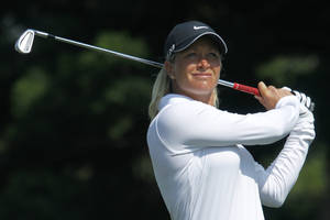 Photo - Suzann Pettersen of Norway, tees off the 2nd hole during the last day of the LPGA Taiwan Championship tournament at the Sunrise Golf & Country Club, Sunday, Oct. 27, 2013, in Yangmei, northern Taiwan. (AP Photo/Wally Santana)