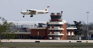 Photo - The University of Oklahoma announced this week it will temporarily use bridge funding to keep the control tower operating at the university's Max Westheimer Airport in Norman. Photo by Steve Sisney, The Oklahoman