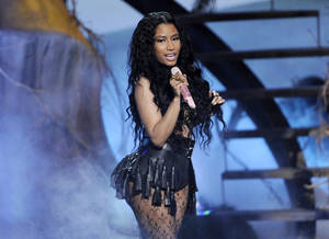 """This June 29, 2014 file photo shows singer Nicki Minaj performing at the BET Awards in Los Angeles. Minaj's """"Anaconda"""" video has racked in 35 million views since its Tuesday, Aug. 19, release and has trended on Twitter throughout the week. (Photo by Chris Pizzello/Invision/AP, File)"""