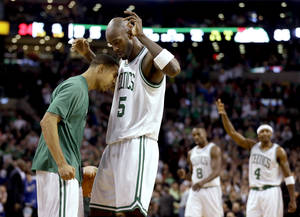 photo - Boston Celtics guard Courtney Lee, left, and forward Kevin Garnett (5) celebrate on the sideline after a score against the Miami Heat as forward Jeff Green (8) and guard Jason Terry (4) walk up during the fourth quarter of an NBA basketball game at TD Garden in Boston, Sunday, Jan. 27, 2013. The Celtics won 100-98 in double overtime. (AP Photo/Steven Senne)