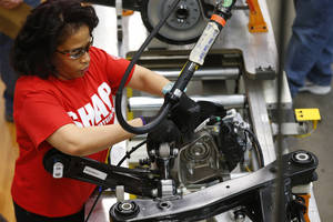 Photo - In this March 14, 2014 photo, an assembly line worker builds a 2015 Chrysler 200 automobile at the Sterling Heights Assembly Plant in Sterling Heights, Mich. The Commerce Department releases factory orders for May on Wednesday, July 2, 2014.  (AP Photo/Paul Sancya)