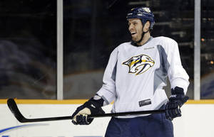 Photo - Nashville Predators defenseman and captain Shea Weber laughs after scoring a goal at NHL hockey training camp, Wednesday, Jan. 16, 2013, in Nashville, Tenn. The shortened, 48-game season begins Saturday, Jan. 19. (AP Photo/Mark Humphrey)