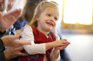 "Sydney Young, 2, claps to music by Ellis Paul on Sunday at a free family concert at the Santa Fe Depot in Norman. Paul performed songs from his newest family music album, ""The Hero in You,"" in a free, family-friendly concert Sunday at the Santa Fe Depot. Paul's appearance was sponsored by the Performing Arts Studio, based at the depot. PHOTO BY SARAH PHIPPS, THE OKLAHOMAN"