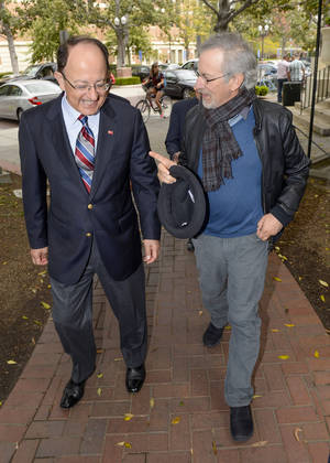 "Photo - This image provided by the University of Southern California shows director Steven Spielberg, right, with USC President C.L. Max Nikias, making their way to the USC Shoah Foundation's announcement of the Center for Advanced Genocide Research at University of Southern California, Friday, April 25, 2014, in Los Angeles. Spielberg announced the creation of a research center that will study how and why genocide occurs, its impact and what steps might be taken to prevent such mass violence. Spielberg, who's a Shoah Foundation trustee, says the research will provide a ""a beacon of hope in breaking the cycle that leads to mass violence."" (AP Photo, USC, Gus Ruelas)"