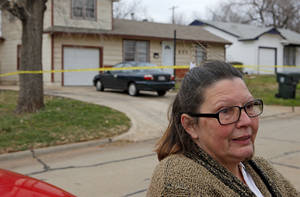 photo - Joan Williams, a neighbor, talks outside the house where a woman was found dead in Midwest City, Okla., Wednesday, Jan. 11, 2012. Photo by Bryan Terry, The Oklahoman