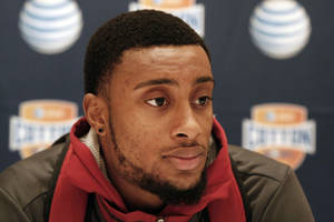 photo - Oklahoma junior defensive back Aaron Colvin answers questions during a press conference for the Cotton Bowl NCAA college football at the Omni Mandalay hotel, Tuesday, Jan. 1, 2013, in Irving, Texas. Oklahoma plays Texas A&M on Jan. 4 in the Cotton Bowl in Arlington, Texas. (AP Photo/Brandon Wade) ORG XMIT: TXBW118