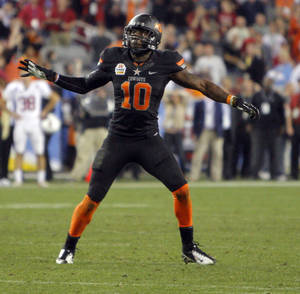 Photo - COLLEGE FOOTBALL / CELEBRATION: Oklahoma State's Markelle Martin (10) celebrates a missed Stanford field goal in overtime during the Fiesta Bowl between the Oklahoma State University Cowboys (OSU) and the Stanford Cardinals at the University of Phoenix Stadium in Glendale, Ariz., Tuesday, Jan. 3, 2012. Photo by Sarah Phipps, The Oklahoman