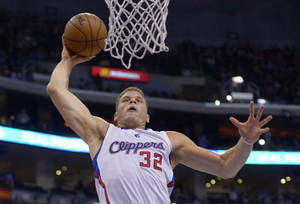 Photo - Los Angeles Clippers forward Blake Griffin goes up for a dunk during the first half of an NBA basketball game against the Washington Wizards, Wednesday, Jan. 29, 2014, in Los Angeles. (AP Photo/Mark J. Terrill)