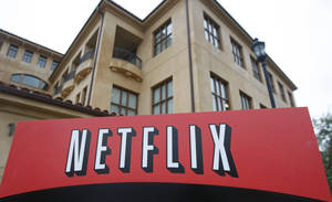 Photo - FILE - This Jan. 29, 2010, file photo, shows the company logo and view of Netflix headquarters in Los Gatos, Calif. Netflix reports quarterly earnings on Monday, Oct. 21, 2013. (AP Photo/Marcio Jose Sanchez, File)
