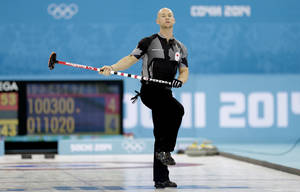 Photo - Ryan Fry of Canada watches the rock during the men's curling competition against Britain at the 2014 Winter Olympics, Saturday, Feb. 15, 2014, in Sochi, Russia. (AP Photo/Wong Maye-E)