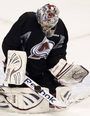 Photo - Colorado Avalanche goalie Semyon Varlamov, of Russia, blocks a shot during NHL hockey practice, Thursday Jan. 17, 2013, in Denver, Colo. (AP Photo/Brennan Linsley)