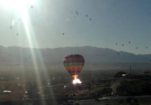 "Photo - In this photo provided by the Catalyst, the balloon ""New Mexico Sunrise"" strikes a power line after launching during Wednesday Oct. 9, 2013, mass ascension at the 2013 Albuquerque International Balloon Fiesta in Albuquerque, N.M. (AP Photo/The Catalyst, Greg Abernathy)"