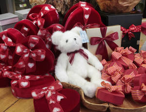 Photo - Chocolates and a stuffed bear at Trochta's Flowers & Greenhouses. Florists are finding alternatives to add to flower arrangements as a helium shortage limits balloons. Photos by David McDaniel, The Oklahoman
