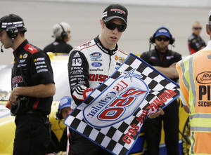 Photo - Brad Keselowski signs an autograph before qualifying for the NASCAR Nationwide auto race, Saturday, Aug. 3, 2013, at Iowa Speedway in Newton, Iowa. (AP Photo/Charlie Neibergall)