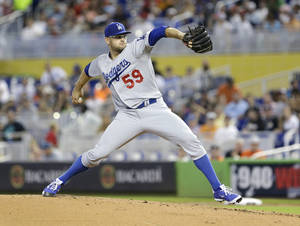 Photo - Los Angeles Dodgers' Stephen Fife delivers a pitch during the first inning of a baseball game against the Miami Marlins, Sunday, May 4, 2014, in Miami. (AP Photo/Wilfredo Lee)