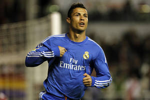 Photo - Real Madrid's Cristiano Ronaldo, from Portugal, celebrates after scoring the opening goal during Spanish La Liga soccer match between Real Madrid and Rayo Vallecano at the Vallecas stadium in Madrid, Saturday, Nov. 2, 2013. (AP Photo/Francisco Seco)