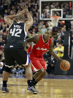 Photo - Los Angeles Clippers guard Jamal Crawford, right, dribbles past Sacramento Kings forward Chuck Hayes during the first quarter of an NBA basketball game in Sacramento, Calif., Friday, Nov. 1, 2013. (AP Photo/Rich Pedroncelli)