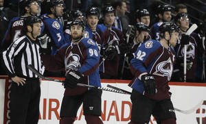 photo - Colorado Avalanche center Ryan O'Reilly (90) is congratulated by teammates after scoring a goal against the Chicago Blackhawks in the second period of an NHL hockey game in Denver, Friday, March 8, 2013. Avalanche left wing Gabriel Landeskog, right, of Sweden, heads back to the ice. (AP Photo/David Zalubowski)