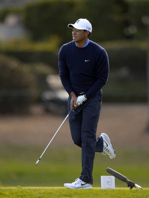 Photo - Tiger Woods reacts to his tee shot on the third hole during the first round of the Northwestern Mutual World Challenge golf tournament at Sherwood Country Club, Thursday, Dec. 5, 2013, in Thousand Oaks, Calif. (AP Photo/Mark J. Terrill)