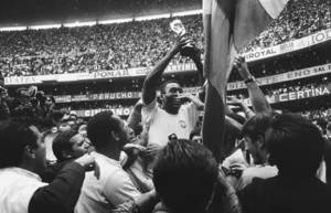 """Photo - FILE - The June 21, 1970 file photo shows Brazil's """"King"""" Pele as he has a big smile as he holds the Jules Rimet Trophy, following Brazil's victory over Italy in the World Cup final on June 21, 1970 at the Azteca Stadium, Mexico City. Brazil won 4-1 and was given the Jules Rimet Trophy permanently in recognition of its third victory. (AP Photo)"""