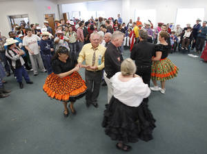 Photo - Members of the Central District Square Dance Association dance at a Dale Rogers Center party honoring Dale Evans Rogers' 100th birthday.   Photo By David McDaniel, The Oklahoman <strong>David McDaniel - The Oklahoman</strong>