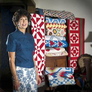 Photo - Author Judy Howard is celebrating her 30th anniversary of owning Buckboard Quilts in Oklahoma City. Howard has antique quilts listed on www.BuckboardQuilts.com.  PHOTO TAKEN SEPT 2005.  Judy Howard,  73142 - BuckboardQuilts@cox.net  Photographer: Keith Rinearson Date Submitted: Monday, April 3, 2006 17:36:04