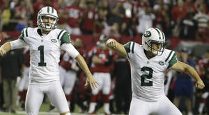 Photo - New York Jets kicker Nick Folk (2) celebrates his field goal with Ryan Quigley (1) against the Atlanta Falcons during the second half of an NFL football game, Monday, Oct. 7, 2013, in Atlanta. The Jets won 30-28. (AP Photo/David Goldman)