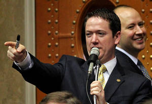 photo -   FILE - In this May 18, 2012 file photo, Missouri Republican House Speaker Tim Jones tries to move the agenda along with Democratic House Minority Leader Mike Talboy, background right, at the State Capitol in Jefferson City, Mo. Jones wants to advance a conservative agenda that includes tax cuts, business incentives and education reform. The state&#039;s new GOP supermajority could trump any objections by Democrats. (AP Photo/St. Louis Post-Dispatch, Laurie Skrivan, File)  