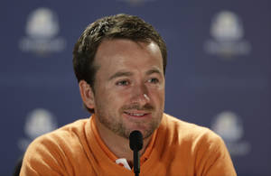 Photo -   Europe's Graeme McDowell answers a question during a news conference for the Ryder Cup PGA golf tournament Tuesday, Sept. 25, 2012, at the Medinah Country Club in Medinah, Ill. (AP Photo/Chris Carlson)