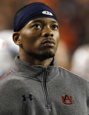 Photo - Auburn quarterback Nick Marshall watches from the sidelines out of uniform after suffering an injury during the first half of an NCAA college football game against Florida Atlantic on Saturday, Oct. 26, 2013, in Auburn, Ala. (AP Photo/Butch Dill)