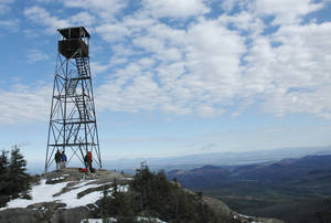 Photo - FILE--In this Oct. 23, 2010 file photo, the Hurricane Mountain fire tower is seen in Keene, N.Y. It is one of two historic fire towers closed for more than 20 years that could be reopened under a plan to boost tourism in the Adirondack Mountains. The state Department of Environmental Conservation said recently that restoring the Hurricane Mountain and St. Regis Mountain fire towers would allow full public access. The plans also call for interpretive materials related to the towers' history. (AP Photo/Mary Esch, File)