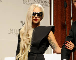 Photo - Lady Gaga wears her nails long, pointed and in dramatic shades of deep red, metallics and black. Photo provided. <strong></strong>