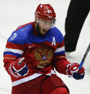Photo - Russia forward Ilya Kovalchuk reacts after Kovalchuk scoring a goal against Norway in the second period of a men's ice hockey game at the 2014 Winter Olympics, Tuesday, Feb. 18, 2014, in Sochi, Russia. (AP Photo/Julio Cortez)