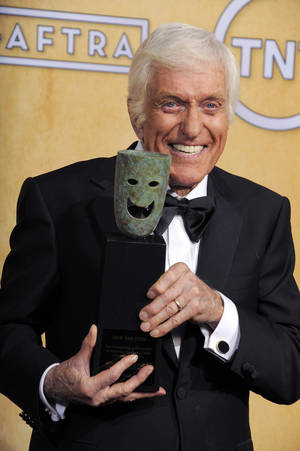 Photo - Actor Dick Van Dyke poses backstage with his life achievement award at the 19th Annual Screen Actors Guild Awards at the Shrine Auditorium in Los Angeles on Sunday Jan. 27, 2013. (Photo by Chris Pizzello/Invision/AP)