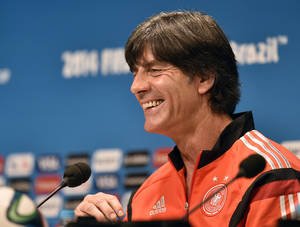 Photo - Germany's head coach Joachim Loew smiles to the media during a press conference one day before the World Cup quarterfinal soccer match between Germany and France at the Maracana Stadium in Rio de Janeiro, Brazil, Thursday, July 3, 2014. (AP Photo/Martin Meissner)