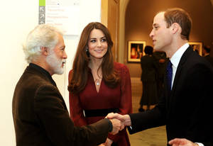 photo - The Duke and Duchess of Cambridge meet artist Paul Emsley after viewing the newly-commissioned portrait of The Duchess of Cambridge at the National Portrait Gallery in central London, Friday Jan. 11, 2013. (AP Photo/PA, John Stillwell)