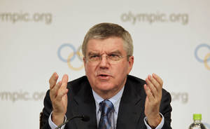 Photo - International Olympic Committee President Thomas Bach speaks during a press conference in Tokyo, Wednesday, Nov. 20, 2013. Bach said there is a possibility that baseball and softball could be included in the program for the 2020 Olympics in Tokyo. The two sports failed in a bid to be reinstated for the Olympic program for 2020 and 2024 at an IOC vote in September but Tokyo's winning bid has refueled calls for them to be included when the Japanese capital hosts the games. (AP Photo/Junji Kurokawa)