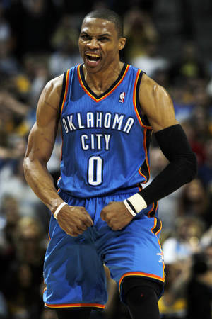 photo - Oklahoma City Thunder guard Russell Westbrook reacts after tying the score to force overtime during the fourth quarter of an NBA basketball game against the Denver Nuggets, Sunday, Jan. 20, 2013, in Denver. (AP Photo/David Zalubowski) ORG XMIT: CODZ115