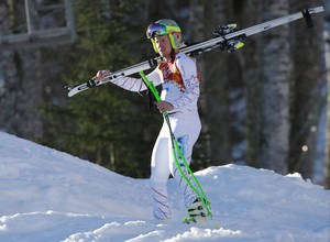 Photo - United States' Ted Ligety leaves after a men's supercombined downhill training run at the Sochi 2014 Winter Olympics, Wednesday, Feb. 12, 2014, in Krasnaya Polyana, Russia. (AP Photo/Gero Breloer)
