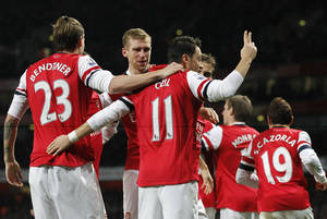 Photo - Arsenal's Mesut Ozil, center, celebrates his goal against Hull City with teammates during their English Premier League soccer match at Emirates Stadium in London, Wednesday, Dec. 4, 2013. (AP Photo/Sang Tan)