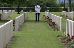 Photo - Britain's Prince Harry visits the Cassino's Commonwealth War  Cemetery at the end of a ceremony on the occasion of the 70th anniversary of the WWII's Monte Cassino battle in Cassino, Italy, Monday, May 19, 2014. (AP Photo/Alessandra Tarantino, Pool)