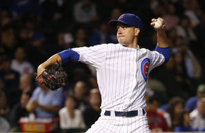 Photo - Chicago Cubs starting pitcher Chris Rusin delivers during the first inning of a baseball game against the Pittsburgh Pirates Tuesday, Sept. 24, 2013, in Chicago. (AP Photo/Charles Rex Arbogast)