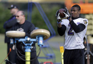 Photo - Baltimore Ravens wide receiver Jacoby Jones catches a pass over his shoulder during an NFL Super Bowl XLVII practice on Friday, Feb. 1, 2013, in Metairie, La. The Ravens face the San Francisco 49ers in Super Bowl XLVII on Sunday, Feb. 3. (AP Photo/Patrick Semansky)