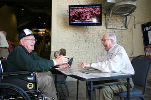 Photo -   Robert Rosendahl, left, of Springfield, Mo., shares stories with WWII veteran volunteer Tom Blakey, at the National World War II Museum in New Orleans, Wednesday, Oct. 3, 2012. Four survivors of a WWII prison camp, two captured at Bataan, two at Corregidor, and families of other Mukden POWs, are holding their 29th reunion in New Orleans. A visit to the World War II Museum was the first thing on their schedule. (AP Photo/Janet McConnaughey)