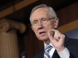 Photo -   Senate Majority Leader Harry Reid of Nev. gestures as he discusses Tuesday's election results during a news conference on Capitol Hill in Washington, Wednesday, Nov. 7, 2012. (AP Photo/Susan Walsh)